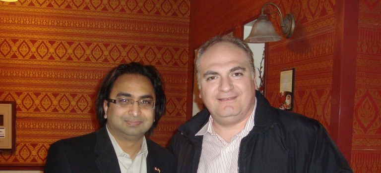 Husain (L) with Jean-Philippe Tachdjian