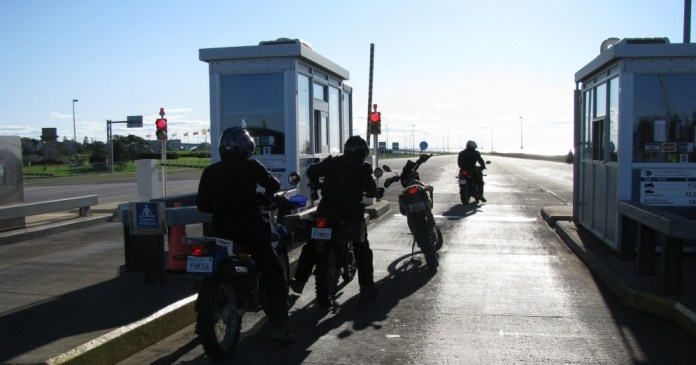 Dawn-til-Dusk riders at the Confederation Bridge tollbooth, leaving PEI.