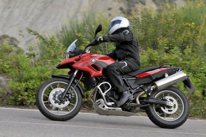 Get your BMW F700 GS to a dealer and have them bring your sidestand up to spec.