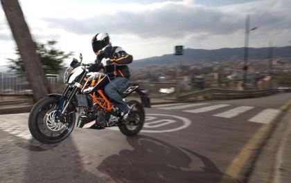 Mash that Moto3 racer up with this 390 Duke, and you'll get KTM's new RC390.