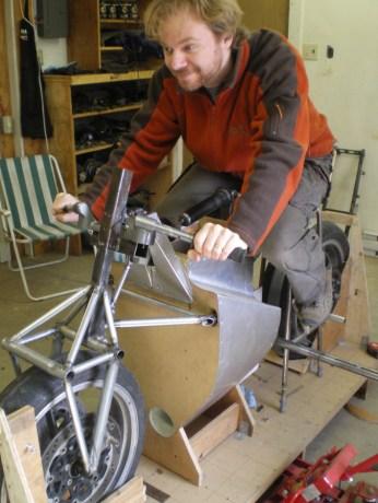 Designer Uhlarik sits aboard a prototype chassis. Photo: Arash Moallemi