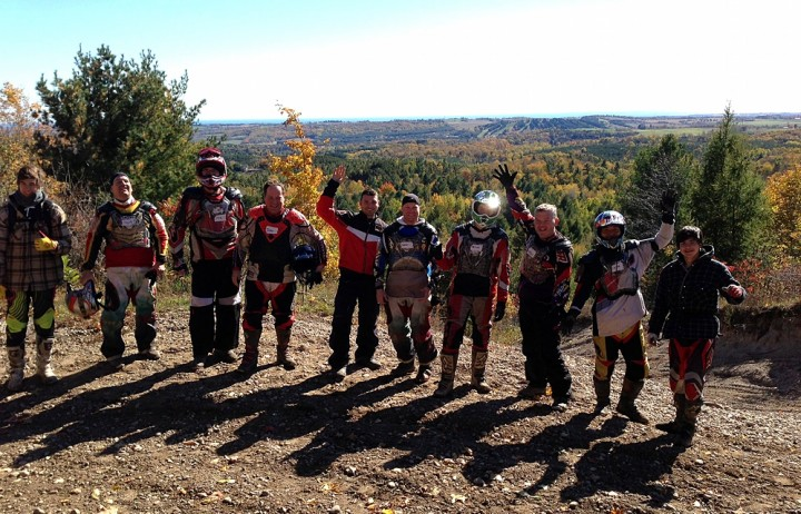 Here's a load of happy Trail Tours customers atop a park lookout. Photo: Facebook