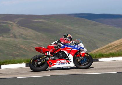 John McGuinness won the Senior race, and set a lap record at  211.8 km/h. Photo: TT Legends