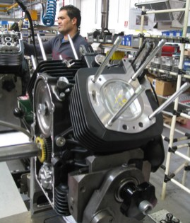 A Guzzi motor gets bolted together at the factory.