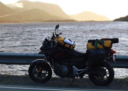 I've been using hammocks on all my motorcycle camping trips for the last year, to get a feel for three different models. I'm quite comfortable sleeping in them now. Here, I have two different test hammocks strapped to my NC700X just outside Harbour Breton, NL. Photo: Zac Kurylyk