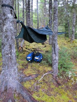 If you want to keep your gear dry in a rain storm, you'll have to stow it under your hammock. Photo: Tammy Perry