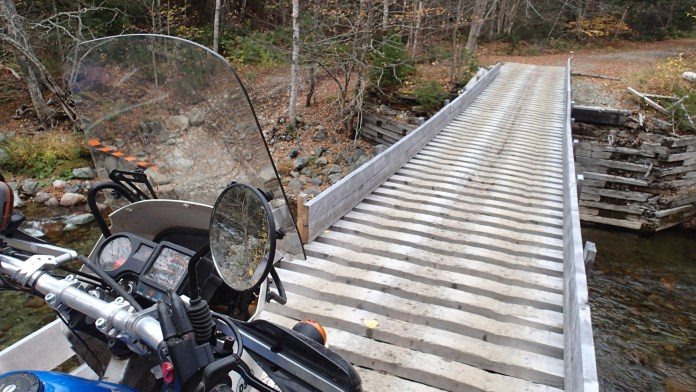 I figured if this bridge could take an ATV then it could take a KLR. Stopping midway to take a snap maybe not the best idea though.