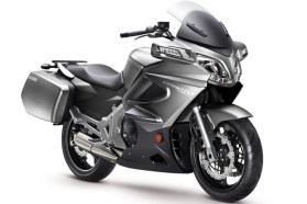 The 650TK has hard bags and a full fairing.