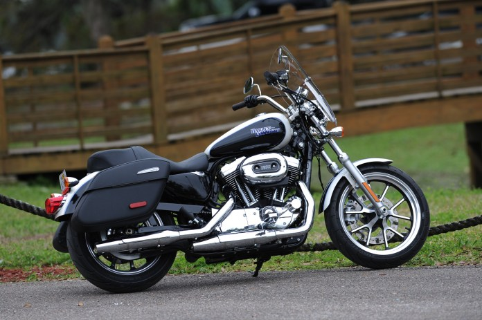 The windscreen and saddlebags mean this Sportster is set up for touring.