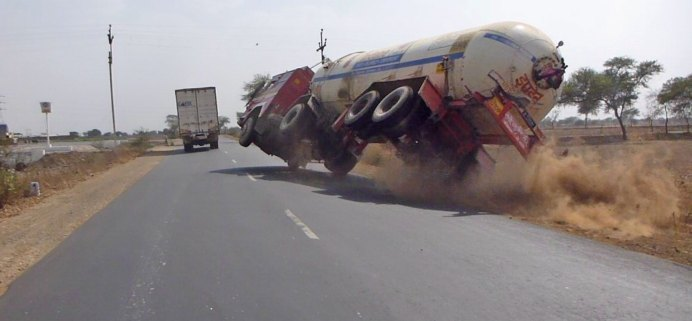 es I actually took this picture whilst in India. I was filming one handed whilst riding behind this petrol tanker because I thought he was about to do something stupid......he didn't disappoint.