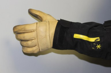 Open up the cuffs, and your gloves will fit into the sleeves.