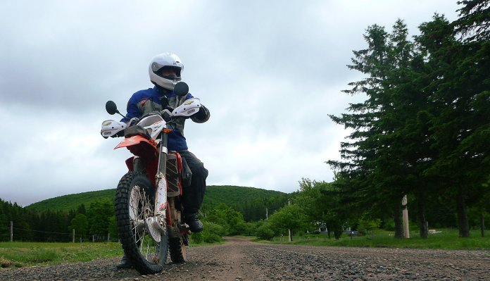 The Scott jacket and pants were my go-to gear for the summer, including a couple tours in Nova Scotia. The dual sport tour I did through the Cape Breton Highlands was a good challenge for the gear's sturdiness. Note the pants in this shot are Scott's rain overpants - I went with these, instead of the zip-in liners. Photo: Zac Kurylyk