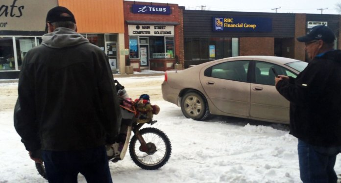 We stopped in a Chinese restaurant in Rosetown, Saskatchewan for some lunch. As normal a crowd had gathered around the bikes outside the window. When we went to pay, someone had secretly paid for our bill without telling us.