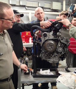 Gary keeps a close eye on the technicians as they reassemble the motor.
