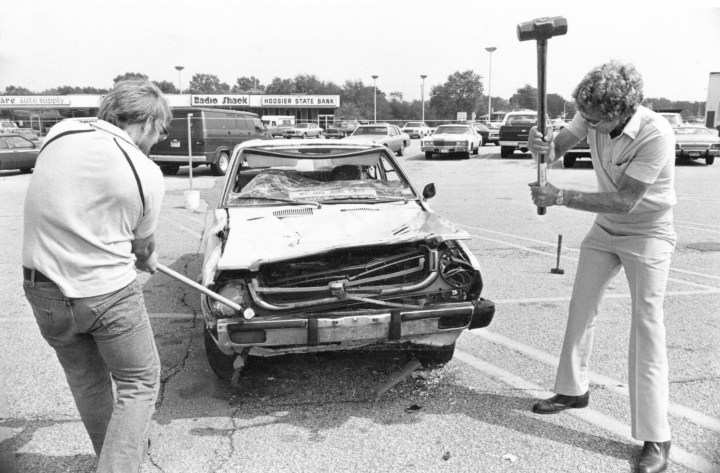 """The sign clearly says 'Chevy parking only'!""  Two thugs smash a Toyota at a Steelworkers Union party in 1982.  (AP Photo)"