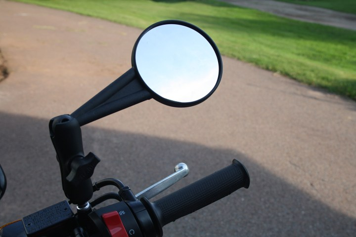 The Double Take mirror cleverly combines a RAM fittingwith the OEM mirror mounts.