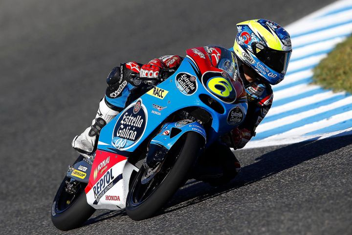 Maria Herrea racing in the Moto3 Grand Prix world championship.  Her diminutive size certainly does not hurt her aboard a 100kg motorcycle.