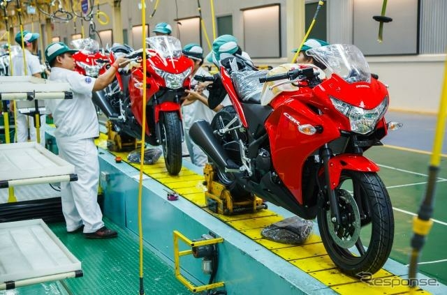 The dream come true : motorcycles assembled on a mass production line at Honda Thailand.