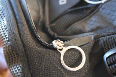 The zipper failed and without straps to act as a backup, dropped the contents of the backpack on the floor.