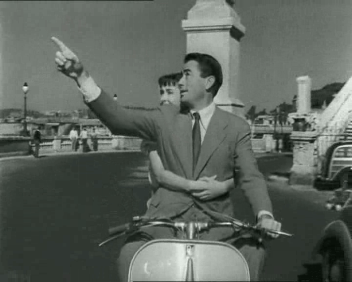 There is no denying that this image makes Vespa serious cool. But who among us has the Hollywood looks and can tool around post-war Rome in a suit with Audrey?