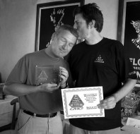 Mark Richardson gets his stupendous winnings for being the Maddest Bastard of the media at the 2005 scooter rally.