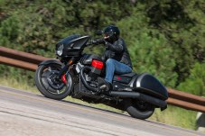 Touring bikes usually come with hard luggage as stock, unless they're cruisers, which are sometimes sold with leather saddlebags.