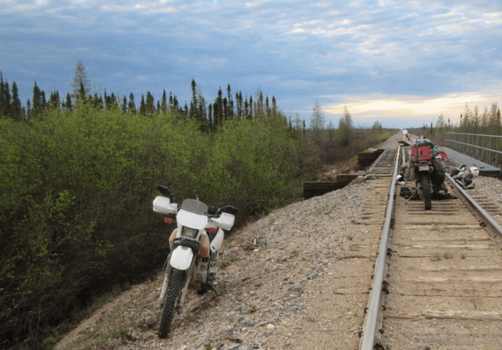 Motorcyclists assess broken rail line to Churchill, Manitoba