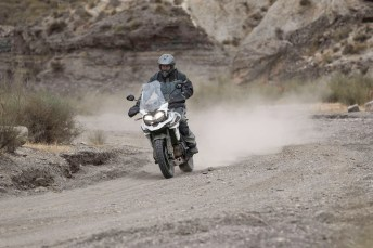 The Triumph Tiger 1200 is a good example of a flagship adventure bike: huge, packed with technology and horsepower, and expensive. Most don't venture too far off-road, but here, Bert shows the Triumph can handle some gravel just fine.