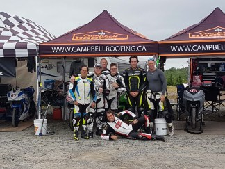Adolfo Silva, Aaron Burns, Alan Burns, Matt Simpson, Connor Campbell, Ryan White, and some fat Aussie pose in Little Bike Alley