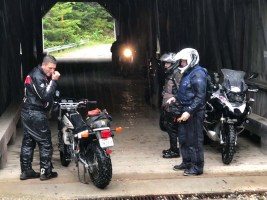 Shame! Zac hangs out at the Forty Five River covered bridge with some other riders, who took pity on his lack of preparation and shared their granola bars with him. Photo: Chris Nielsen