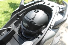 It's large enough for a full-size helmet, with the seat locked shut.