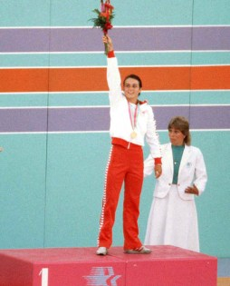Canada's Sylvie Bernier celebrates a gold medal win in the women's diving event at the 1984 Olympic games in Los Angeles. (CP PHOTO/ COA/Ted Grant) Sylvie Bernier du Canada célèbre après avoir remporté une médaille d'or en plongeon aux Jeux olympiques de Los Angeles de 1984. (Photo PC/AOC)