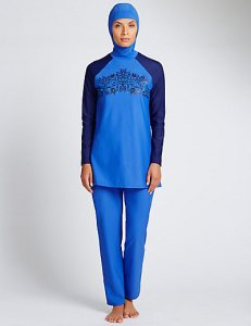 [A model posing in a blue burqini made by Marks & Spencer.]