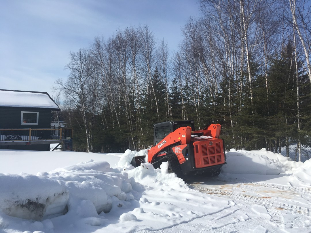 clearing snow at Canadian fly in fishing