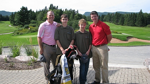 Hanging at Highlands: Robert Thompson (left, in pink, of course), Whitman Design Associate Keith Cutten, and caddies Taylor Hardy-Scott (left center) and Zach Hardy (right center)