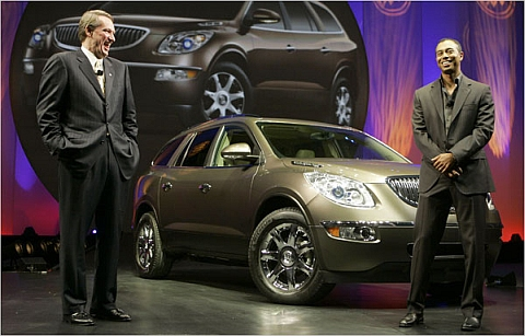 """You know Rick, I'm never going to drive this..."" Tiger Woods stands with GM CEO Rick Wagoner in 2006."