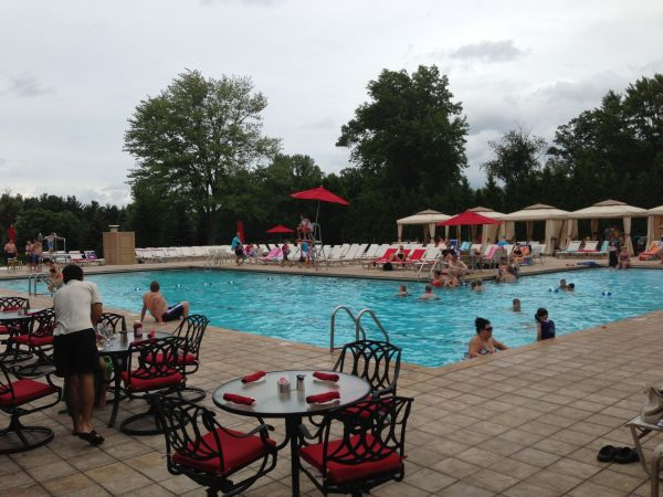 People mill about Squaw Creek's pool on the afternoon of the July 4 holiday.