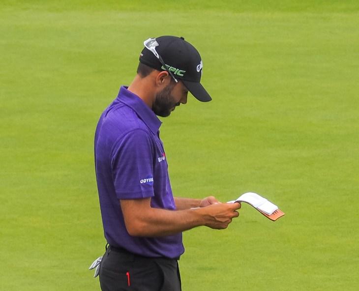 Hadwin checks his yardage book
