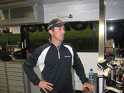 Mike Weir standing in TaylorMade's new tour trailer.
