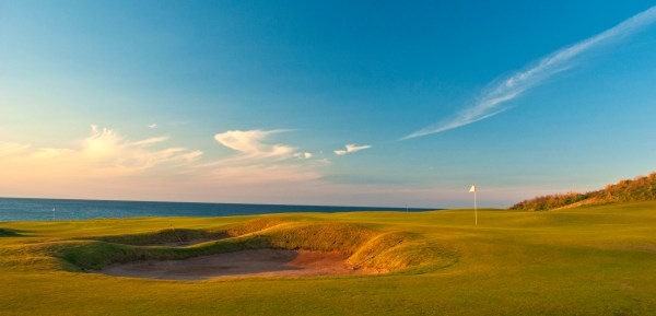 Looking towards the ocean over the double green - 4th and 13th holes at Cabot