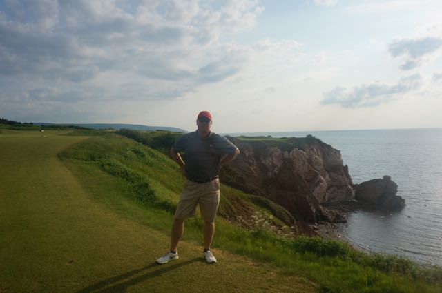 The author stands in front of the most discussed 16th hole.