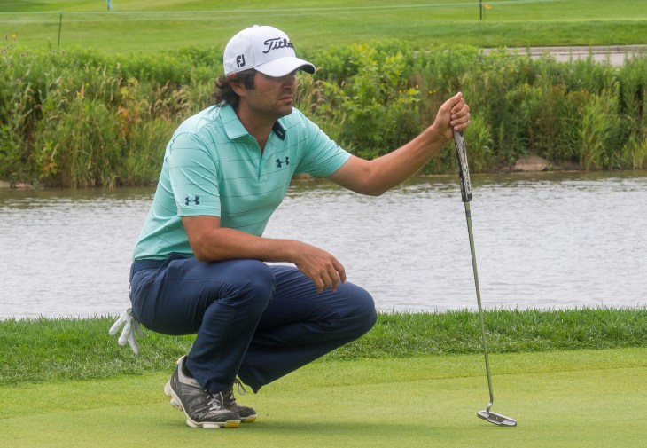 Martin Flores stalks his par putt on 6th on his way to back to back 66s.