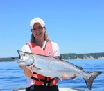 Canadian Golf Traveller publisher, Sharon McAuley, with her Chinook Salmon catch
