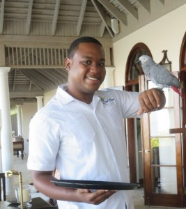Point of View villa at The Tryall Club. Head butler Quenton Morgan poses with the house parrot. (Image: Brian Kendall)