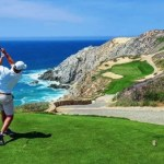 A golfer tees off at Quivira Golf Club in Cabo San Lucas
