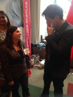 Deniece is depicted here speaking with Dr Eric Hoskins, Ontarios Minister of Health