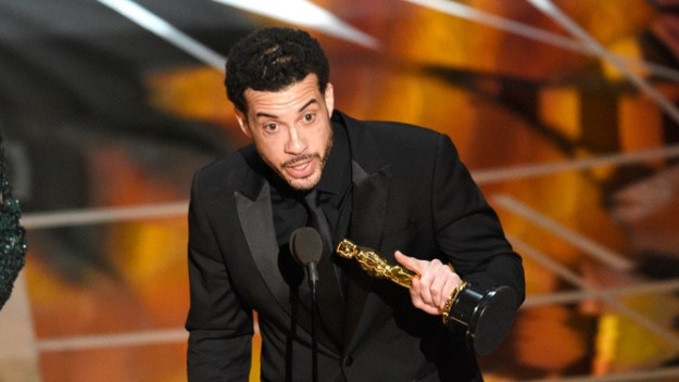 "Ezra Edelman, right, and Caroline Waterlow accept the award for best documentary feature for ""O.J.: Made in America"" at the Oscars on Sunday, Feb. 26, 2017, at the Dolby Theatre in Los Angeles. (Photo by Chris Pizzello/Invision/AP)"