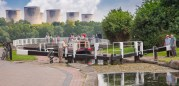 """Three fellas and a boat at the Trent Lock scrutinised by gongoozlers. One boater remarked while struggling to wind a paddle """"I usually get my wife to do this"""". That's normal!"""