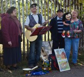 Folk group entertains passers by.