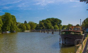 The weir and in centre distance Witchurch Lock at Pangbourne.